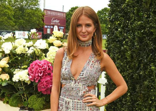 Like many women, Millie Mackintosh doesn't appear to shave her thighs — and she does't seem to care what people think about it. (Photo: Getty)