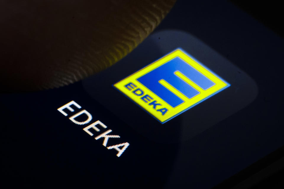 Berlin, Germany - February 07: In this photo illustration the logo of German supermarket chain EDEKA is displayed on a smartphone on February 07, 2019 in Berlin, Germany. (Photo Illustration by Thomas Trutschel/Photothek via Getty Images)