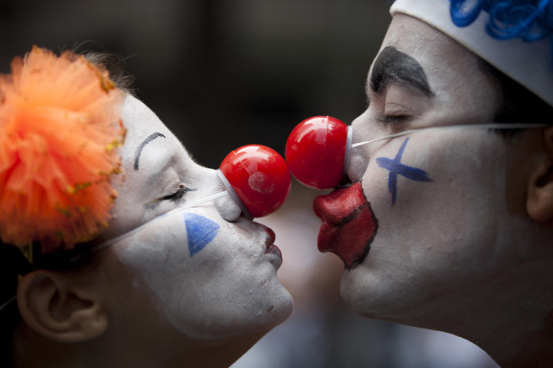 "A couple dressed as clowns participate in the ""Cordao da Bola Preta"" street carnival parade in Rio de Janeiro, Brazil, Saturday, Feb. 9, 2013. According to Rio's tourism office, Rio's street Carnival this year will consist of 492 block parties, attended by an estimated five million Carnival enthusiasts. (AP Photo/Felipe Dana)"