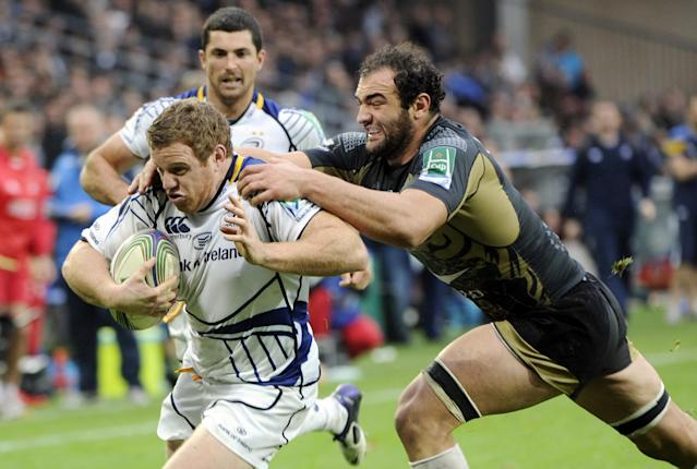 Montpellier's Mamuka Gorgodze (R) vies with Leinster's Sean Cronin (L) on November 12, 2011 at the Mosson stadium in Montpellier, during the Heineken Cup rugby union match Montpellier vs Leinster. AFP PHOTO / ANNE-CHRISTINE POUJOULAT (Photo credit should read ANNE-CHRISTINE POUJOULAT/AFP/Getty Images)