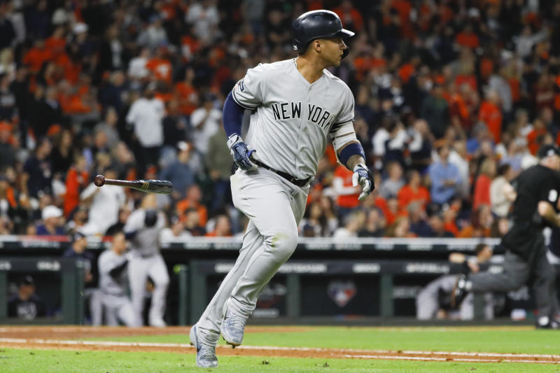 New York Yankees' Gleyber Torres rounds the bases after a run home run during the sixth inning in Game 1 of baseball's American League Championship Series against the Houston Astros Saturday, Oct. 12, 2019, in Houston. (AP Photo/Matt Slocum)