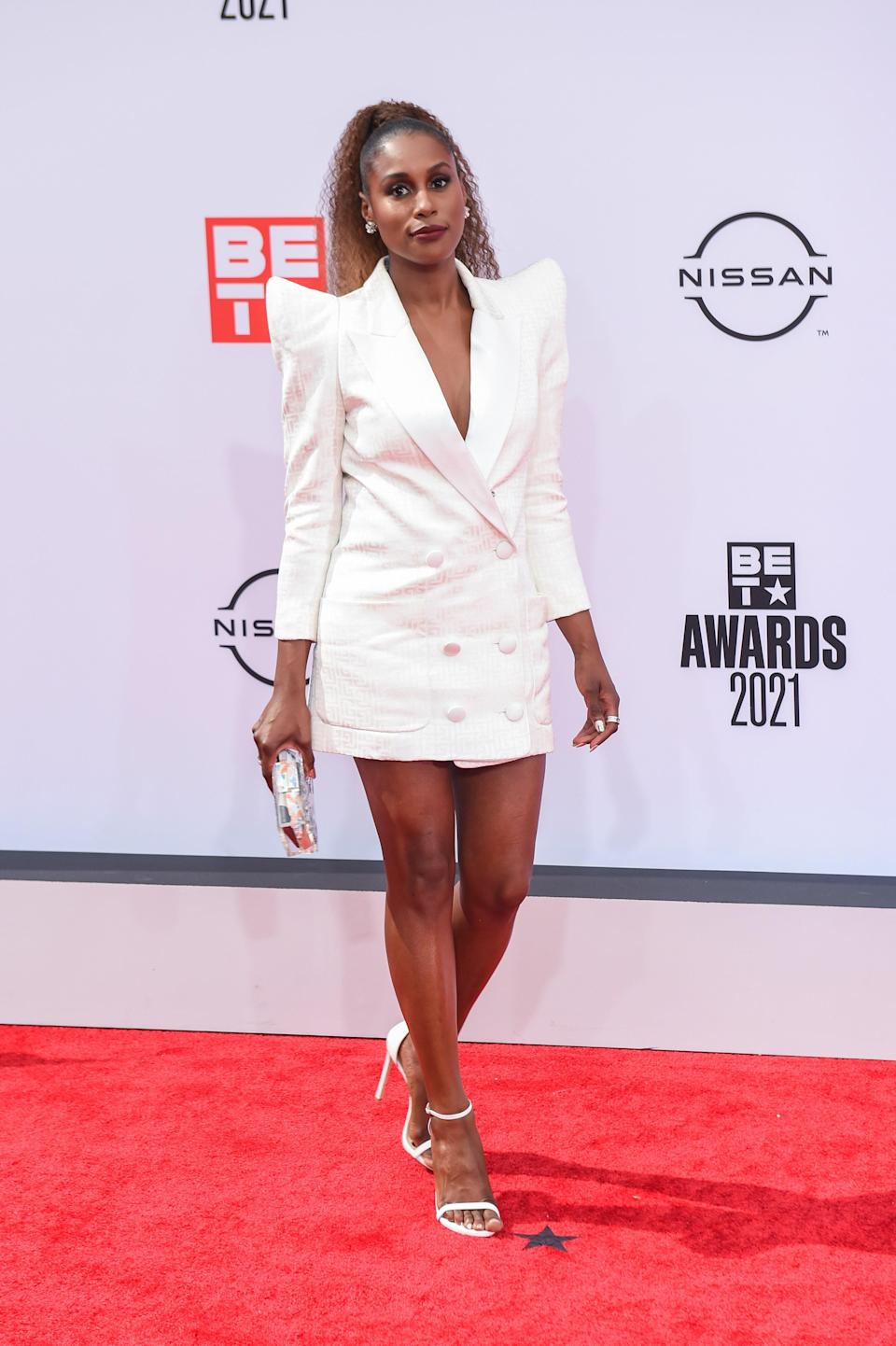 Our favorite Awkward Black Girl came to the BET Awards in a tuxedo dress with Bulgari earrings. Simple yet classy, we love it!