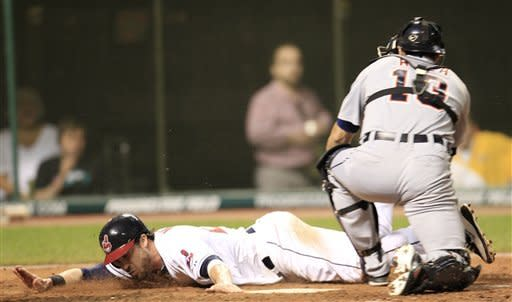 Cleveland Indians' Jason Kipnis tags home plate to score as Detroit Tigers catcher Alex Avila is late on the tag in the eighth inning in a baseball game, Wednesday, May 23, 2012, in Cleveland. Kipnis scored on hit by Travis Hafner. The Indians won 4-2. (AP Photo/Tony Dejak)
