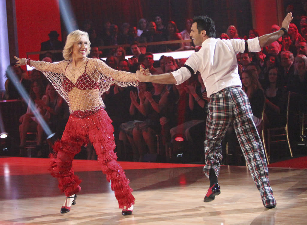 "<p class=""MsoNormal""><span style=""font-size:10.0pt;"">Nine-time Wimbledon singles champion Martina Navratilova paired a skimpy, spiderweb-like top with a red bra and matching fringed trousers while dancing a jive to ""Tell Her About It"" with pro partner Tony Dovolani during Week 2.</span></p>"