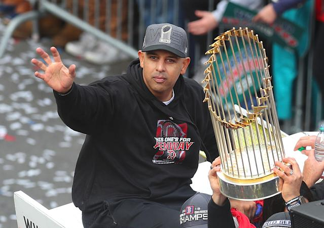 Red Sox Manager Alex Cora waves with the trophy during the Boston Red Sox World Series victory parade down Boylston Street in Boston on Oct. 31, 2018. (Photo by John Tlumacki/The Boston Globe via Getty Images)