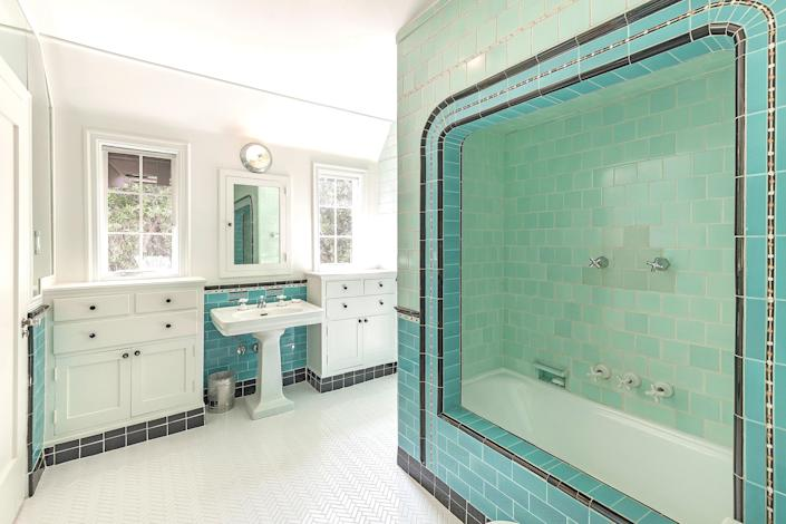 Blue tiles add a pop of color to one bathroom.