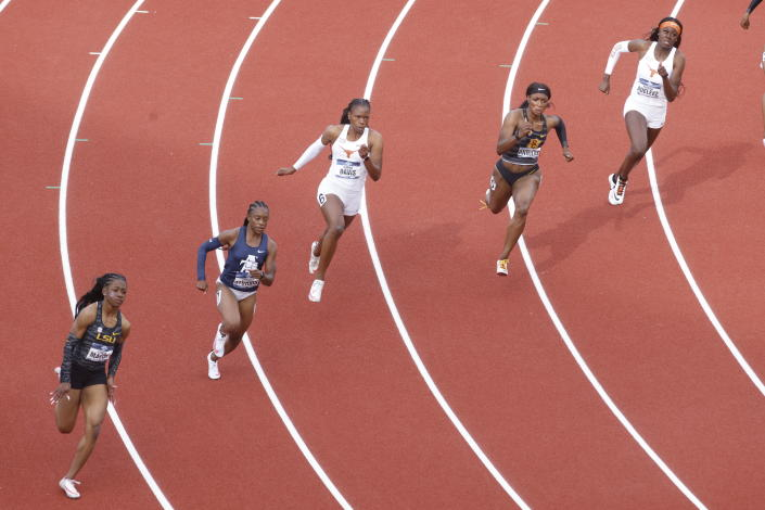 Runners compete in the 200 meter semifinals during the NCAA Division I Outdoor Track and Field Championships, Thursday, June 10, 2021, at Hayward Field in Eugene, Ore. (AP Photo/Thomas Boyd)