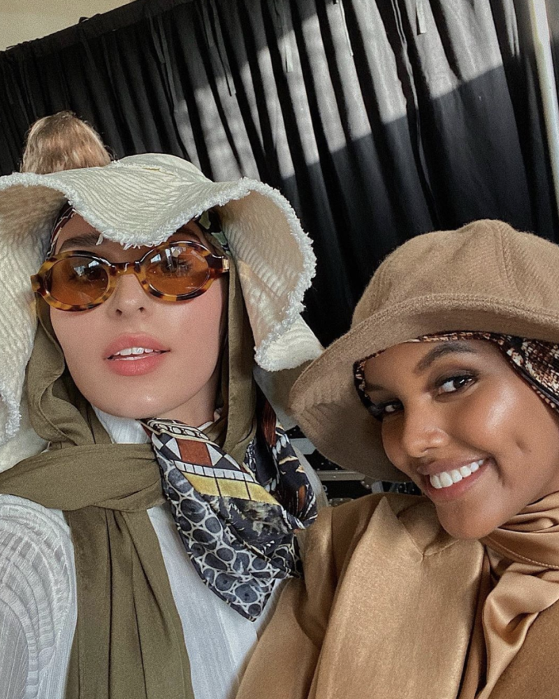 A photo of models Nawal Sari (left) and Halima Aden wearing modest clothing at THE ICONIC Summer Show '19.