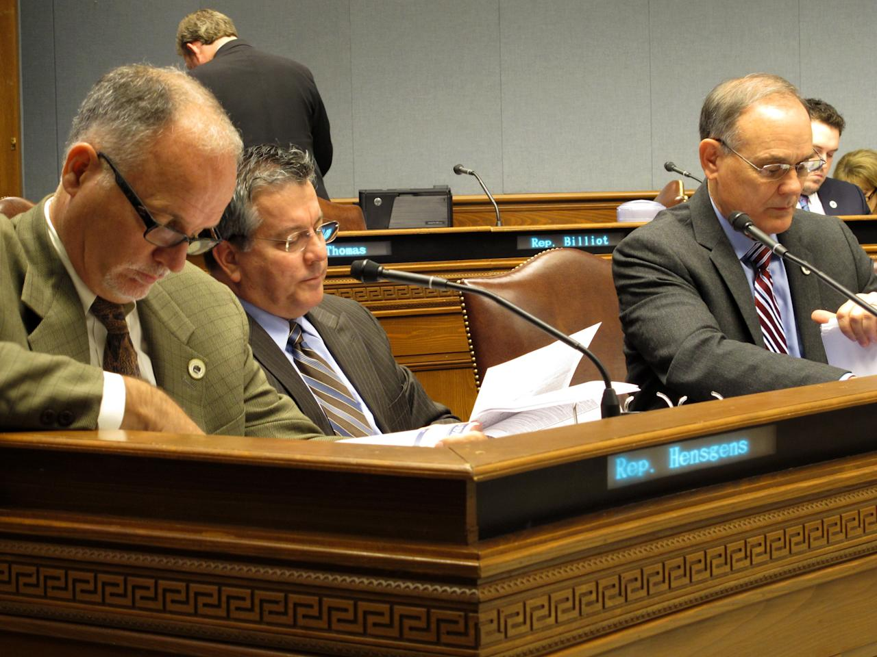 """<p> Reps. Bob Hensgens, R-Abbeville; Jerome """"Zee"""" Zeringue, R-Houma; and Tony Bacala, R-Prairieville, from left to right, look through budget documents, on Wednesday, Dec. 7, 2016, in Baton Rouge, La. The House Appropriations Committee has been holding hearings about how agencies are spending their money this year and what they're requesting next year. (AP Photo/Melinda Deslatte) </p>"""