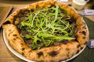 The 10-inch Tartufo pizza that has a truffle mushroom base with parmesan cheese and arugula. Photo: Coconuts
