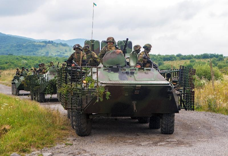 Ukrainian Security forces roll through the village of Bobrovyshche on July 13, 2015 (AFP Photo/Alexander Zobin)