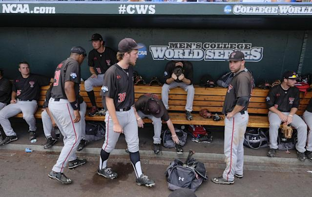 Texas Tech players sit the the dugout following their 2-1 loss to Mississippi in an NCAA baseball College World Series elimination game in Omaha, Neb., Tuesday, June 17, 2014. (AP Photo/Eric Francis)