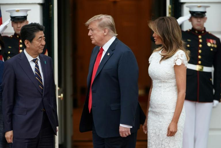 US President Donald Trump and First Lady Melania Trump greet Prime Minister Shinzo Abe at the White House in April 2019 on one of the Japanese leader's many visits
