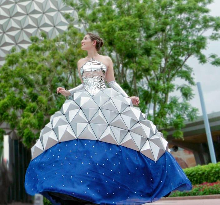 Disney fan Sky dresses as Spaceship Earth at Epcot.