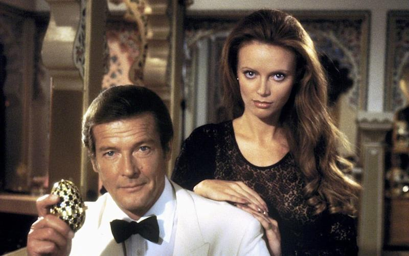 Roger Moore and Kristina Wayborn in Octopussy - Credit: Allstar Picture Library