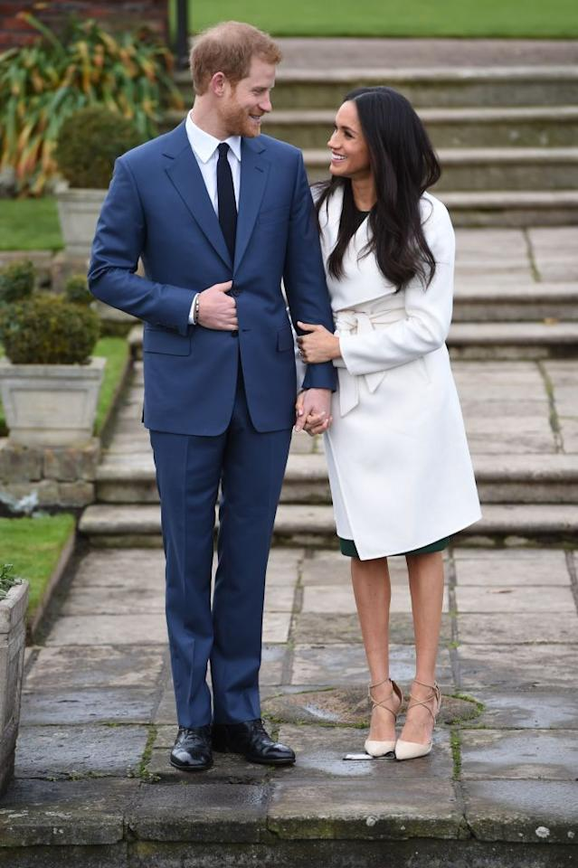 """<p>When Meghan and Harry stepped out for the first time as an engaged couple, the bride-to-be wore a <a href=""""https://www.townandcountrymag.com/society/tradition/a13936308/meghan-markle-engagement-photo-outfit/"""" target=""""_blank"""">chic white coat</a> from Canadian brand <a class=""""body-link"""" href=""""http://www.linethelabel.com/"""" target=""""_blank"""">Line the Label</a>, paired with <a class=""""body-link"""" href=""""http://www.neimanmarcus.com/Aquazzura-Matilde-Crisscross-Suede-105mm-Pump-Nude/prod192700142/p.prod"""" target=""""_blank"""">Aquazurra Matilde Crisscross beige suede heels</a>, and, of course, her sparkly new <a href=""""https://www.townandcountrymag.com/society/tradition/a13090749/meghan-markle-engagement-ring/"""" target=""""_blank"""">engagement ring</a>. </p>"""
