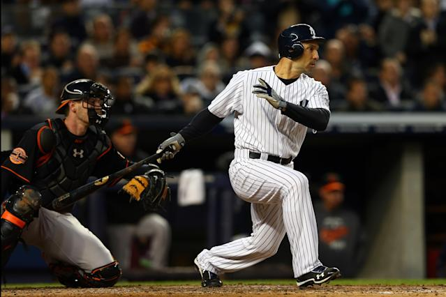 NEW YORK, NY - OCTOBER 12: Raul Ibanez #27 of the New York Yankees hits an RBI single in the fifth inning against the Baltimore Orioles during Game Five of the American League Division Series at Yankee Stadium on October 12, 2012 in New York, New York. (Photo by Elsa/Getty Images)