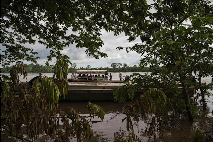Migrants cross the Usumacinta River between La Técnica, Guatemala and Frontera Corozal, Mexico, on Oct. 21. The Usumacinta River acts as a border between the two countries. There is no immigration inspection in either of the two borders in the area.