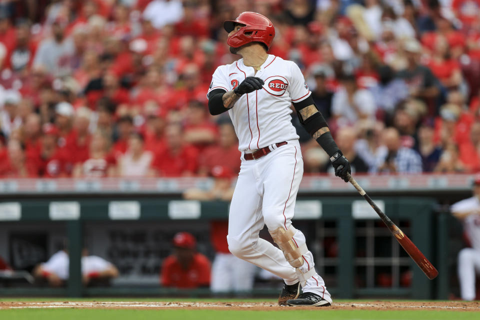 Cincinnati Reds' Nick Castellanos watches as he hits an RBI-sacrifice fly during the first inning of a baseball game against the Atlanta Braves in Cincinnati, Thursday, June 24, 2021. (AP Photo/Aaron Doster)