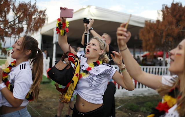 Soccer Football - World Cup - Group F - Germany vs Sweden - Fisht Stadium, Sochi, Russia - June 23, 2018 Germany fan takes a photo before the match REUTERS/Pilar Olivares