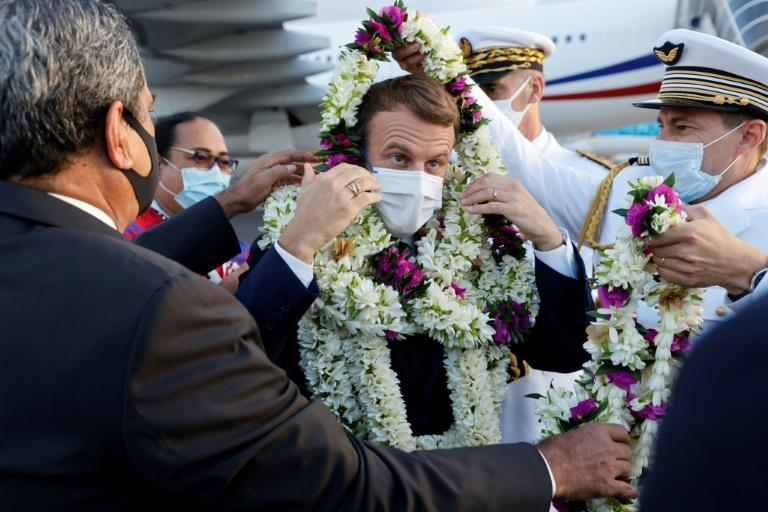 President Emmanuel Macron (C) is making his first official trip to French Polynesia
