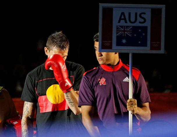 PHOTO: In this July 30, 2021, file photo, Australian Damien Hooper walks to the ring wearing a t-shirt with the Aboriginal flag for his boxing match during the London 2012 Olympic Games. (Murad Sezer/Reuters, FILE)