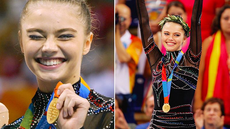 Alina Kabaeva poses with her gold medal from the 2004 Athens Olympic Games.