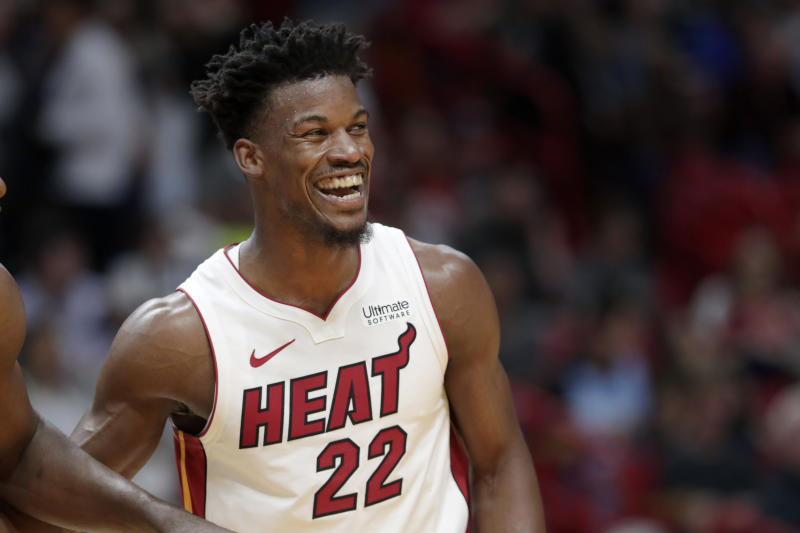 Miami Heat forward Jimmy Butler laughs during the second half of an NBA basketball game against the Toronto Raptors, Thursday, Jan. 2, 2020, in Miami. The Heat won 84-76. (AP Photo/Lynne Sladky)