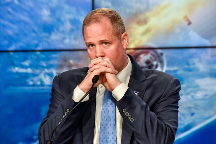 NASA Administrator Jim Bridenstine clasps his hands during a press conference on January 19, 2020.