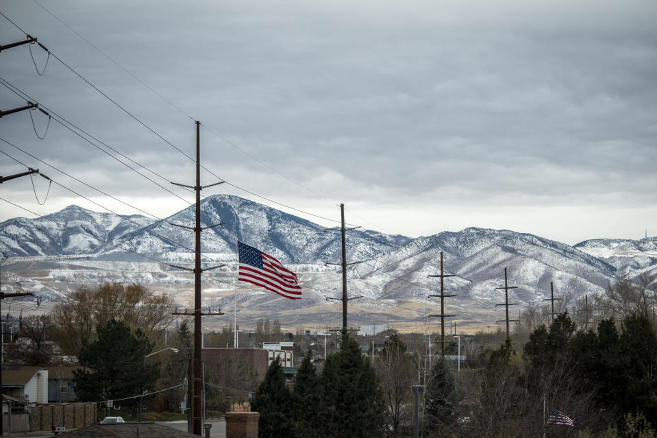 A U.S. flag flies against the mountains in Bountiful, Utah, Sunday, Nov. 15, 2020. Founded by believers in what was then a small, fringe religion, Utah was then lost in the desolation of mountains and deserts, and viewed with suspicion by much of America. The insularity that resulted has been fading over the past few decades, but it's still a place intensely proud of its own distinctiveness. (AP Photo/Wong Maye-E)