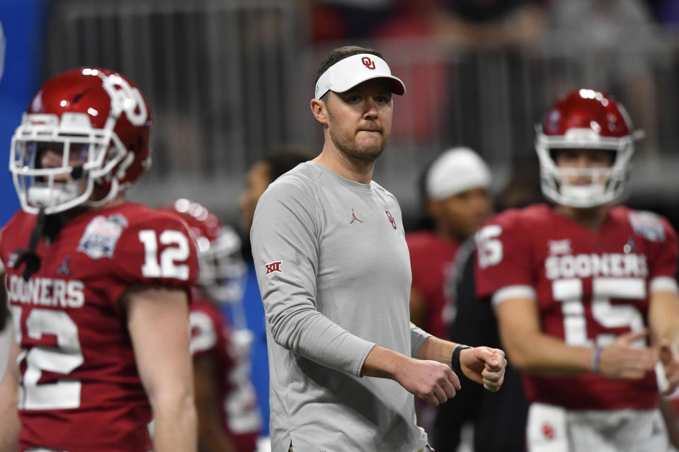 FILE - In this Saturday, Dec. 28, 2019, file photo, Oklahoma head coach Lincoln Riley speaks with his team before the first half of the Peach Bowl NCAA semifinal college football playoff game against LSU, in Atlanta. Riley already has coached Heisman Trophy winners Baker Mayfield and Kyler Murray along with Heisman runner-up Jalen Hurts. Now, he is hoping to build a new tradition at Oklahoma - pulling top quarterbacks to Oklahoma from the high school ranks. Caleb Williams, the No. 1 quarterback in the 247Sports Class of 2021 and ESPNs No. 1 dual-threat quarterback for that class, has committed to OKlahoma.(AP Photo/John Amis, File)