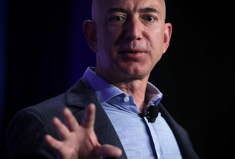 Amazon, whose CEO Jeff Bezos is seen here, posted record profits as it diversified into new areas such as digital advertising and groceries (AFP Photo/ALEX WONG)
