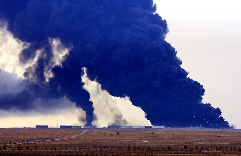 Heavy black smoke rises from an oil facility in northern Libya's Ras Lanouf region on January 23, 2016, after it caught fire following attacks launched by Islamic State group jihadists