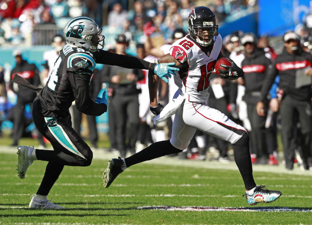 Atlanta Falcons' Mohamed Sanu (12) runs after a catch as Carolina Panthers' James Bradberry (24) defends during the first half of an NFL football game in Charlotte, N.C., Sunday, Dec. 23, 2018. (AP Photo/Jason E. Miczek)