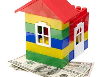 house on dollars isolated on...