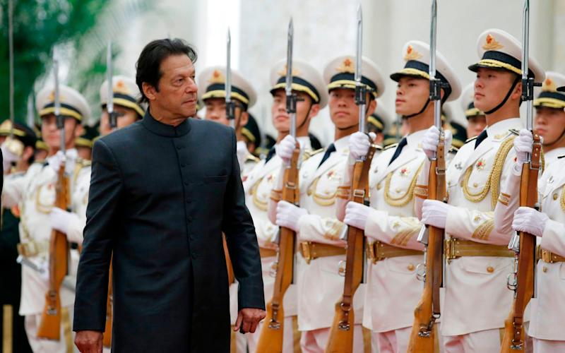 Pakistani prime minister Imran Khan attends a welcome ceremony in China - AFP