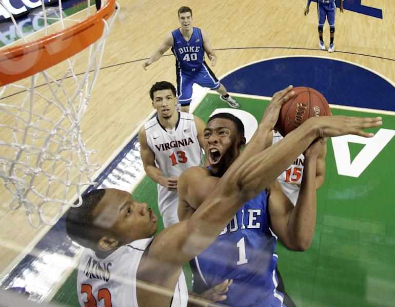 Duke's Jabari Parker (1) tries to shoot over Virginia's Darion Atkins during the first half of an NCAA college basketball game in the championship of the Atlantic Coast Conference tournament in Greensboro, N.C., Sunday, March 16, 2014. (AP Photo/Bob Leverone)