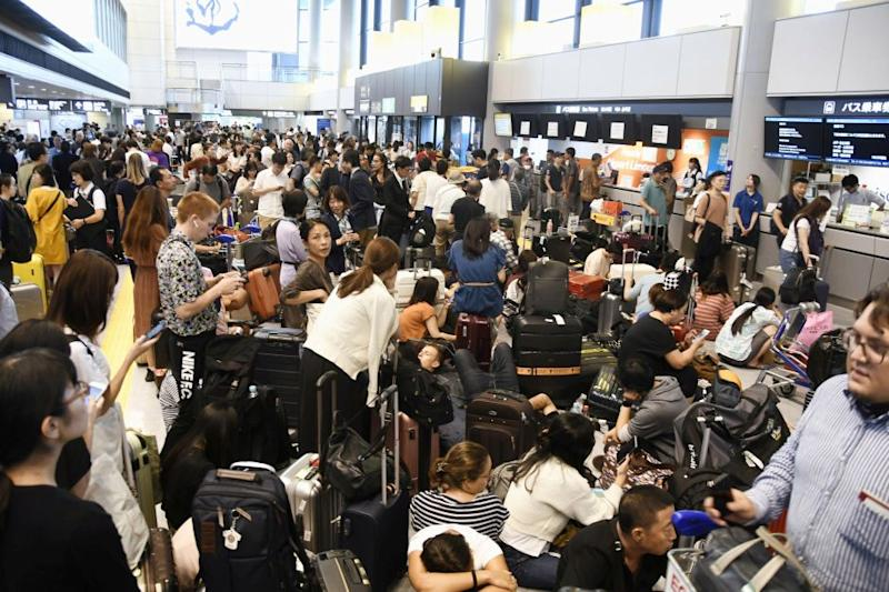 Passengers are stranded after railways and subway operators suspended their services due to Typhoon Faxai, at Narita airport on Sept. 9.