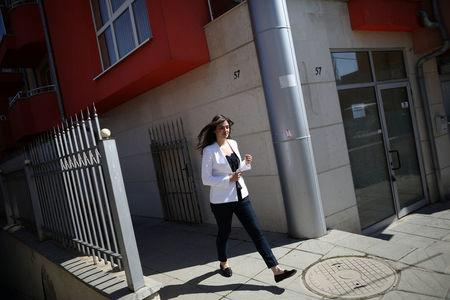 Bulgarian Teodora Yolcheva, 31, a public relations professional, walks outside the apartment building where she lives in Sofia, Bulgaria, March 22, 2017. Picture taken March 22, 2017.  REUTERS/Stoyan Nenov
