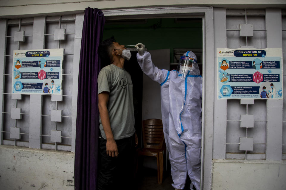 A health worker takes a nasal swab sample to test for COVID-19 in Gauhati, India, Friday, July 16, 2021. (AP Photo/Anupam Nath)