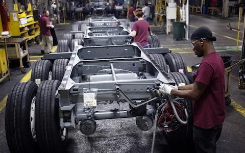 <span>The US automotive sector appears to have suffered most heavily</span> <span>Credit: Luke Sharrett/Bloomberg </span>