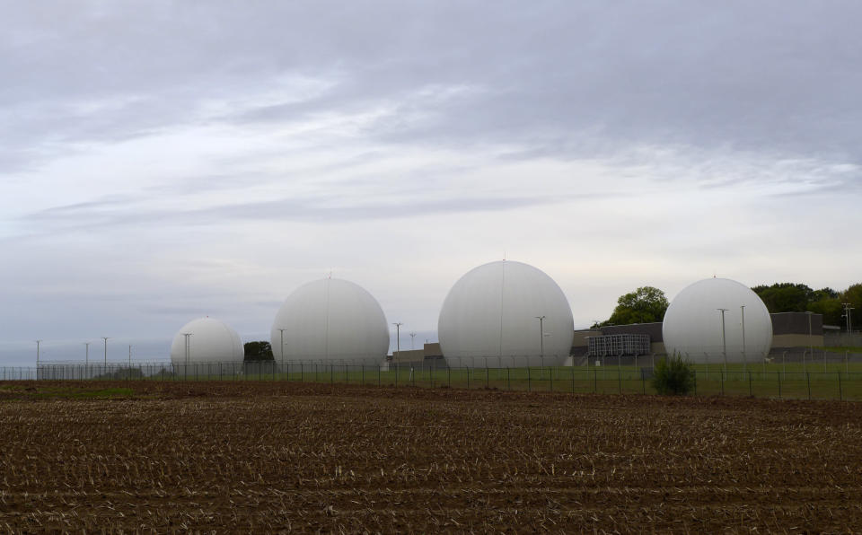 Satellite dishes inside Kevlar domes line a field at the Kester Satellite Ground Station in Kester, Belgium, Thursday, Oct. 15, 2020. This week, the site at Kester, which has been in use for decades but was totally overhauled in 2014, is set to fall under a new orbit, when NATO announces that it is creating a space center to help manage satellite communications and key parts of its military operations around the world. (AP Photo/Lorne Cook)