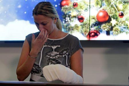 Czech Republic's tennis player Petra Kvitova reacts during a news conference after she was injured on Tuesday when she fought off an intruder in her home, damaging all the fingers on her playing hand, in Prague, Czech Republic December 23, 2016.    REUTERS/David W Cerny/Files