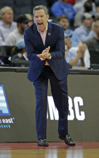 UMBC head coach Ryan Odom directs his team against Kansas State during the first half of a second-round game in the NCAA men's college basketball tournament in Charlotte, N.C., Sunday, March 18, 2018. (AP Photo/Bob Leverone)