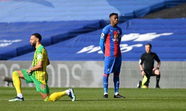 """Wilfried Zaha opts not to take a knee ahead of Crystal Palace's game against West Brom in mid-March. Premier League players and officials performed the anti-racism act ahead of every game for the duration of the season. Palace forward Zaha became the first top-flight player to remain standing since play resumed last June, citing the ineffectiveness of the gesture. """"I feel kneeling has just become a part of the pre-match routine and at the moment it doesn't matter whether we kneel or stand, some of us still continue to receive abuse,"""" he said."""