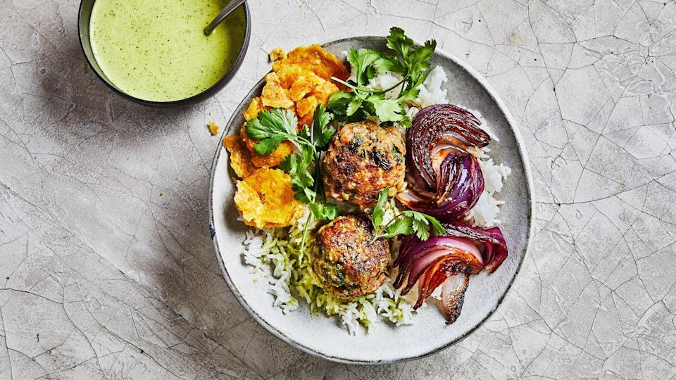 """Inspired by our love of zippy chile-and-garlic-packed Cuban mojo sauce, we transformed the fun and flavor of long-cooked mojo pork into quick weeknight-able meatballs. If you're spice sensitive, split the chiles in half lengthwise and remove the seeds; they hold much of the heat. <a href=""""https://www.bonappetit.com/recipe/mojo-meatballs?mbid=synd_yahoo_rss"""" rel=""""nofollow noopener"""" target=""""_blank"""" data-ylk=""""slk:See recipe."""" class=""""link rapid-noclick-resp"""">See recipe.</a>"""