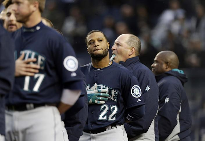 Seattle Mariners' Robinson Cano looks stands during the playing of the national anthem before a baseball game against the New York Yankees, Tuesday, April 29, 2014, in New York. (AP Photo)