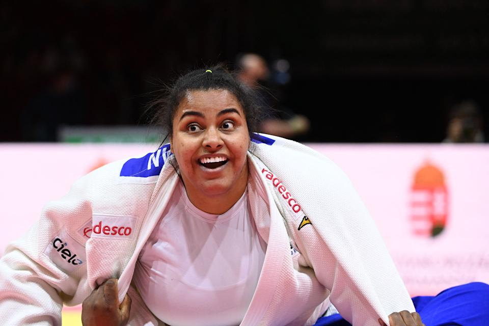 Brazil's Maria Suelen Altheman (white) reacts after her fight against Cuba's Idalys Ortiz (blue) in the bronze match of the women's +78kg category during the seventh day of the 2021 Judo World Championships at 'Papp Laszlo' Arena of Budapest Hungary on June 12, 2021. (Photo by Attila KISBENEDEK / AFP) (Photo by ATTILA KISBENEDEK/AFP via Getty Images)