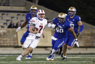 SMU quarterback Shane Buechele (7) is chased by Tulsa defensive lineman Jaxon Player (90) during the second half of an NCAA college football game in Tulsa, Okla., Saturday, Nov. 14, 2020. (AP Photo/Joey Johnson)
