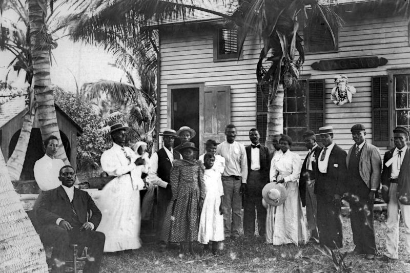 In this photo dated 1890 provided by HistoryMiami, Bahamian immigrants stand outside the Barnacle boathouse in the Coconut Grove neighborhood of Miami. The community was settled by Bahamian immigrants in the 1880's, making it the first black settlement in South Florida. (AP Photo/HistoryMiami)